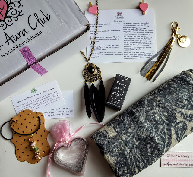 what's in the pink aura club box