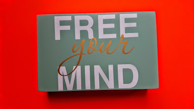 free your mind wall plaque